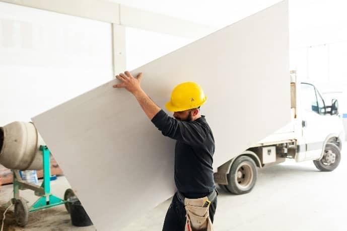 Man Holding Plasterboard